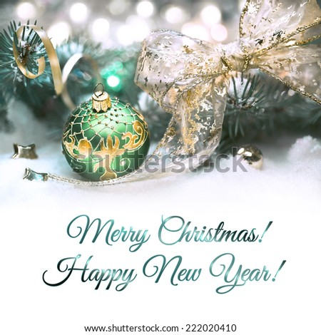 Christmas decorations in green and gold, space for your text - stock photo
