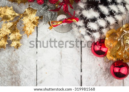 Christmas decorations in red and gold tone on wooden background - stock photo