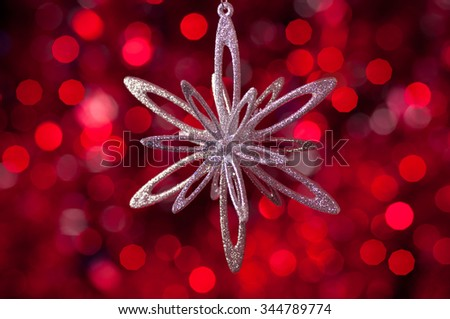 christmas decorations in red tones - blurred background - stock photo