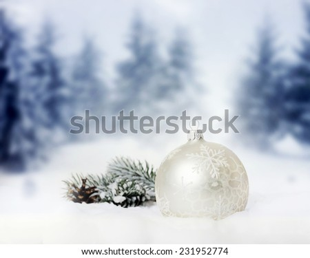 Christmas decorations  in snow - firs in the background - stock photo