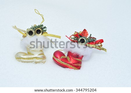 Christmas decorations in the snow. - stock photo