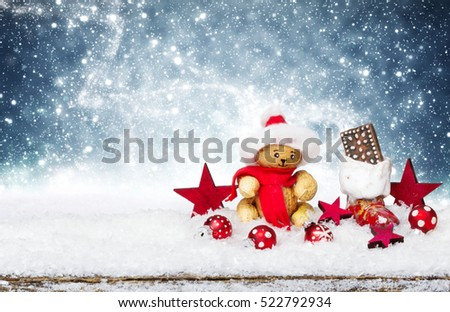 Christmas decorations in the snow against starry sky