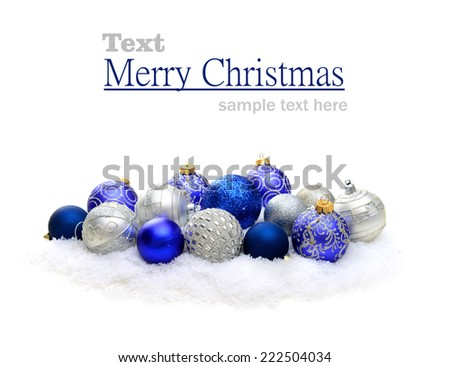 Christmas decorations in the snow on a white background - stock photo