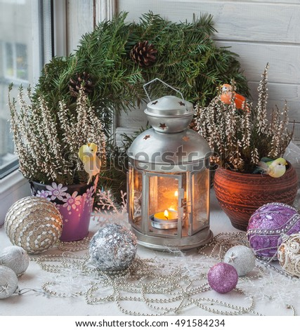 Christmas decorations  in the window eve of holiday (products of mass production)
