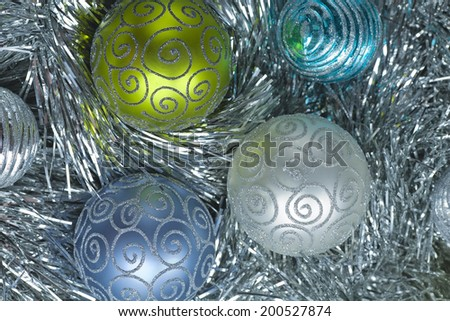 Christmas decorations. New Year ball in tinsel and spangles. - stock photo