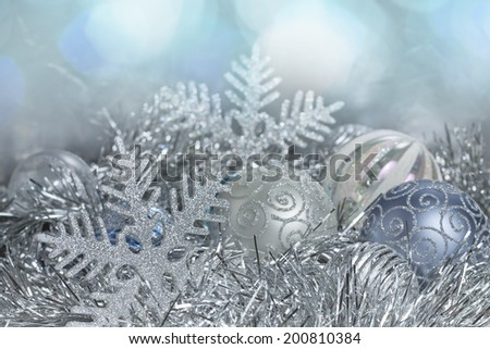 Christmas decorations. New Year balls and snowflakes in tinsel and spangles. - stock photo