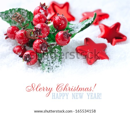 Christmas decorations of bauble are with stars on snow with sample text - stock photo