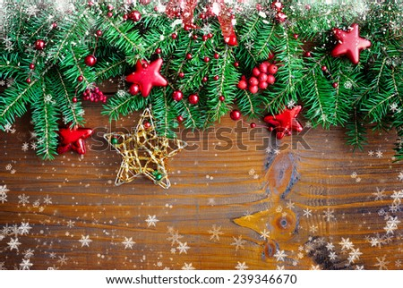 Christmas decorations of bauble with the branches of fir on a wooden background - stock photo