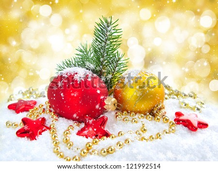 Christmas decorations of bauble with the sprig of fir on snow - stock photo
