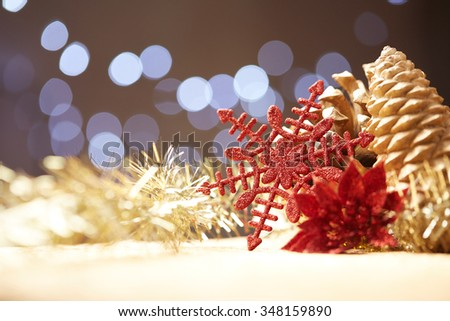 Christmas decorations on a background of lights and glare - stock photo