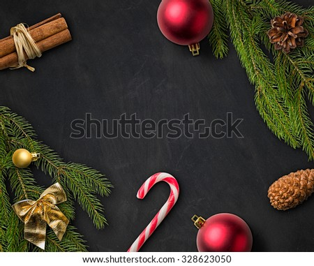 Christmas Decorations on a blackboard - stock photo