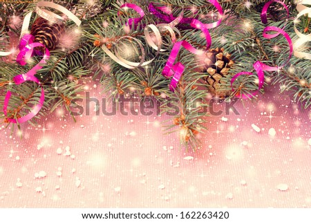 christmas decorations on a pink background - stock photo