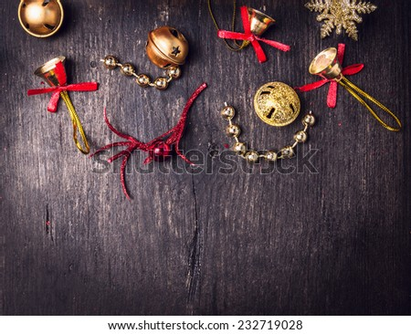 Christmas decorations on dark wooden background, top view - stock photo
