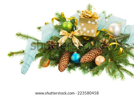 christmas decorations  on evergreen fir tree  with gift box  and blue ribbon  isolated on white background - stock photo