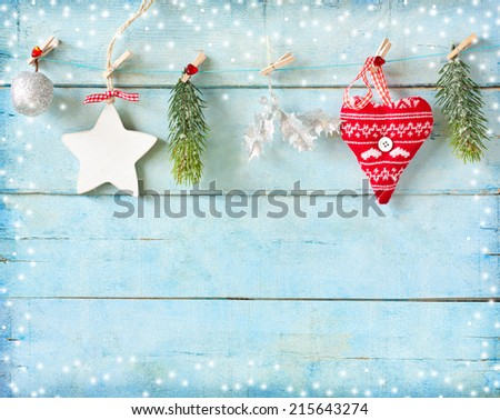Christmas decorations on old blue wood background with copy space for congratulation. - stock photo