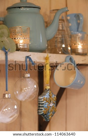 Christmas decorations on the shelf in country house - stock photo