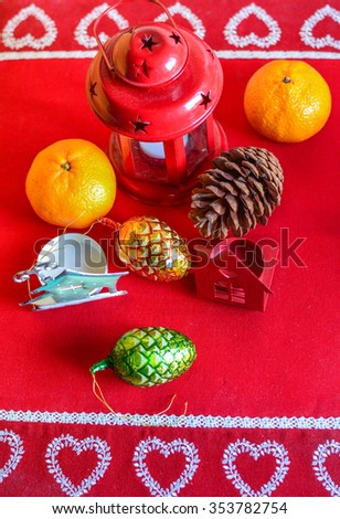 Christmas decorations on the table with red tablecloth - stock photo