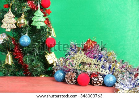 Christmas decorations on the wooden floor of red on a green background.