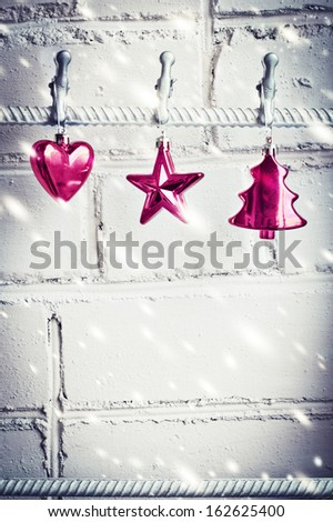 Christmas decorations on white brick wall background  - stock photo