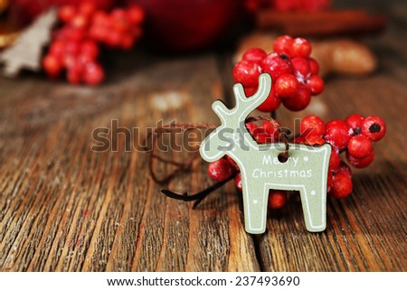 Christmas decorations on wooden table - stock photo