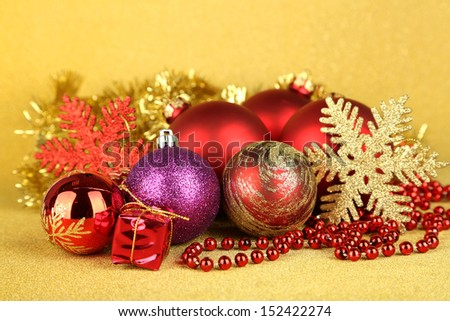 Christmas decorations on yellow background - stock photo
