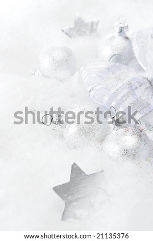 christmas decorations over snow - stock photo