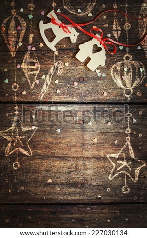 Christmas decorations over wooden background