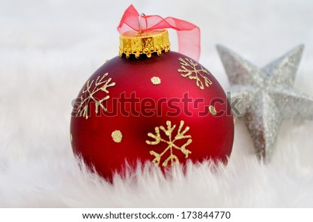 Christmas decorations red and silver on fake fur snow - stock photo