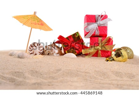 Christmas decorations seashells and starfish on a beach sand on a white background - stock photo