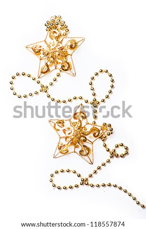 Christmas Decorations - stars and beads on white - stock photo