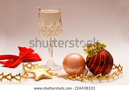 Christmas decorations with a glass of champagne
