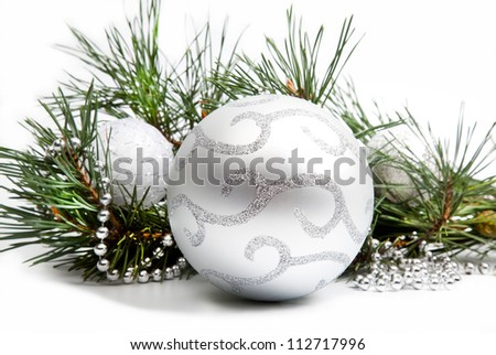 Christmas decorations with big silver ball and silver beads on white background