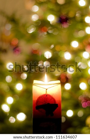 christmas decorations with burning candle