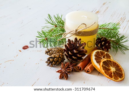 Christmas decorations with candle, white wood background