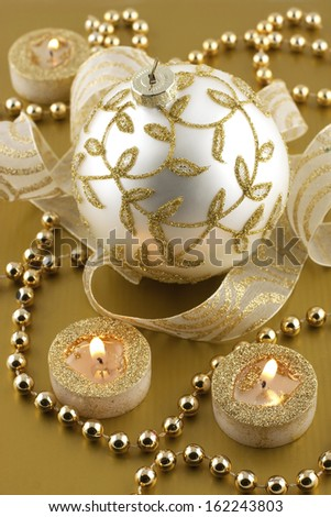 Christmas decorations with  candles and christmas baubles
