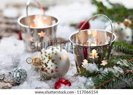 Christmas Decorations with candles in small pails - stock photo
