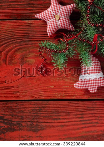 Christmas decorations with fir tree branch on red wooden background - stock photo
