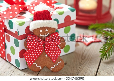 Christmas Decorations with Gingerbread man and Gift Box - stock photo