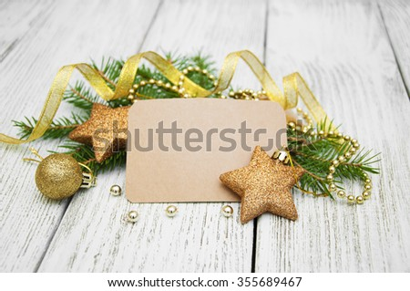 Christmas decorations with greeting card on a white wooden background