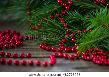 Christmas Decorations with pieces of Xmas Tree on wooden background