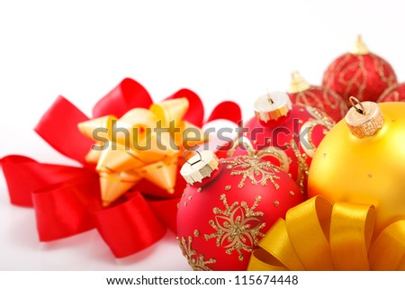 Christmas decorations with ribbons on white background.