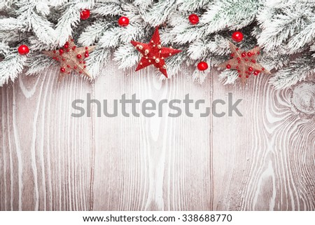 Christmas decorations with stars and snow on wood background - stock photo
