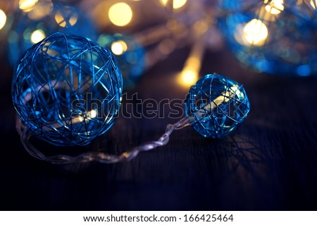 Christmas decorative balls and garland, on wooden background - stock photo