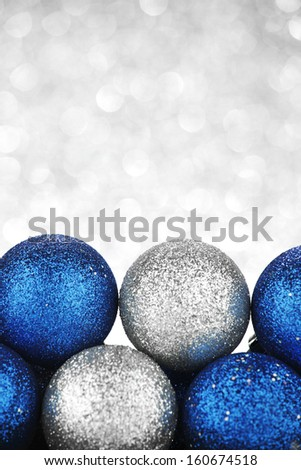 Christmas decorative balls on shiny silver background