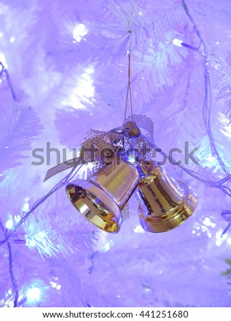 christmas decorative bell on white christmas tree with lighting  - stock photo