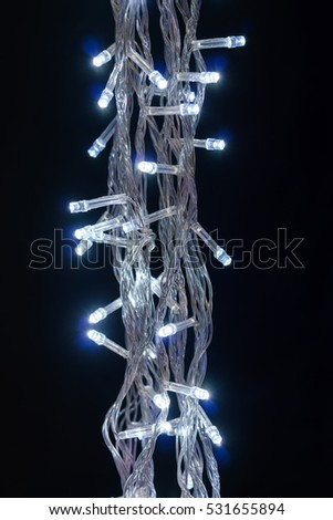 Christmas decorative glittering lights in the dark