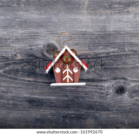 Christmas decorative ornament - Cake house on wooden background - stock photo