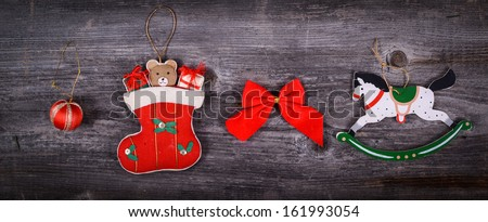 Christmas decorative ornaments on wooden background - stock photo
