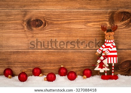 Christmas decorative reindeer on the wooden background.