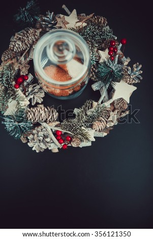 Christmas decorative top view setting. Fir tree, Pine cones, and Spruce. Cinnamon cookies in glass jar - stock photo
